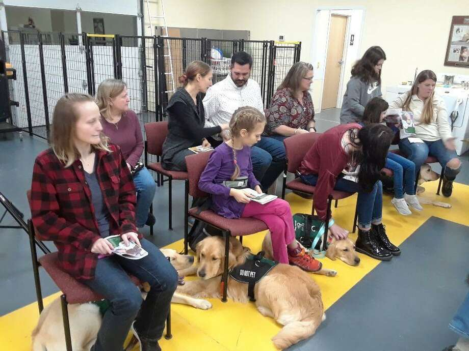 Four clients graduated from service dog training, with their new companion dogs, at ECAD in Winchester on Dec. 18. Photo: Emily M. Olson / Hearst Connecticut Media /