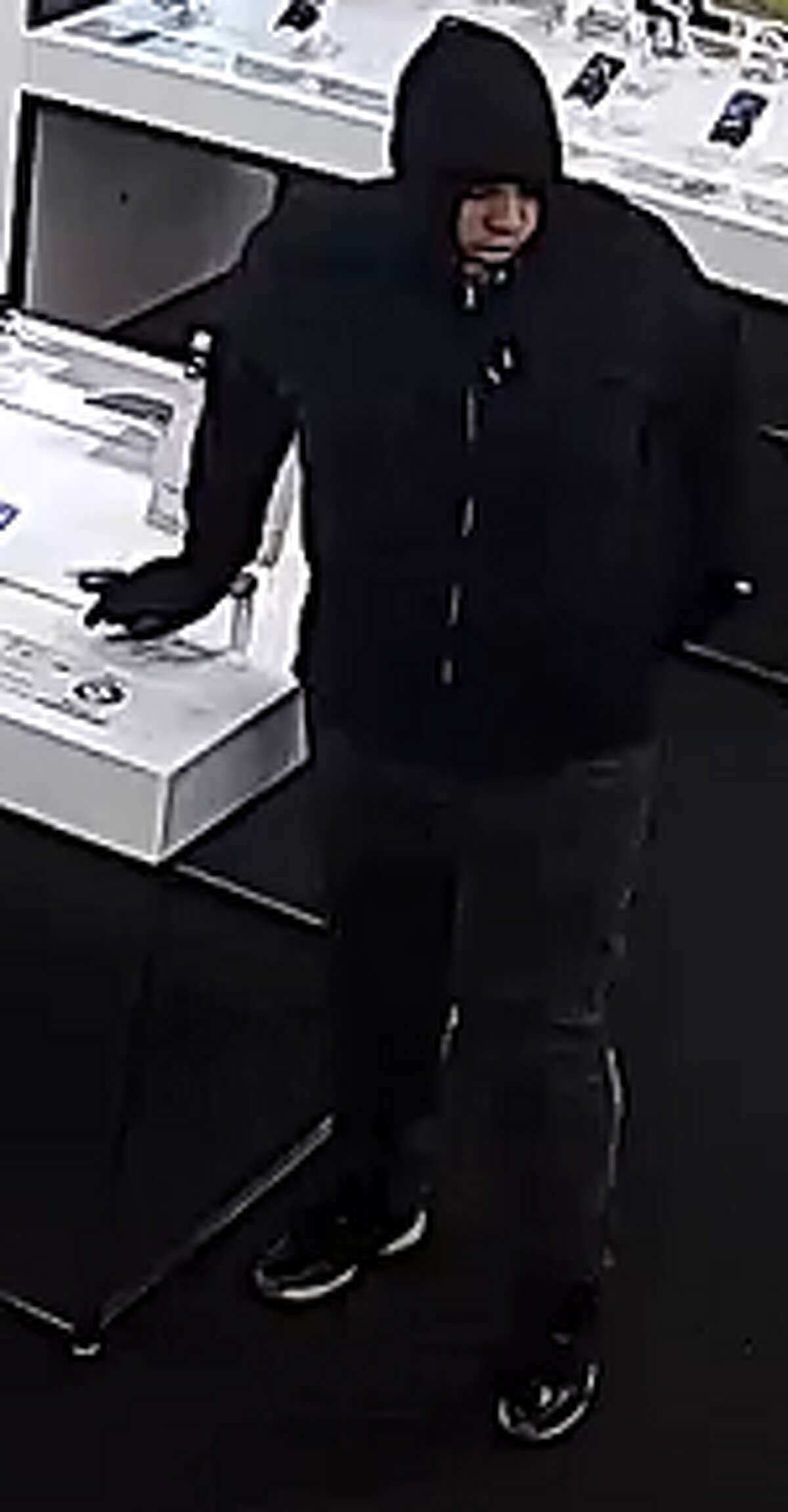 The Pasadena Police Department is searching for five men they said forced a cellphone store employee at gunpoint to open a safe and then made off with store merchandise.
