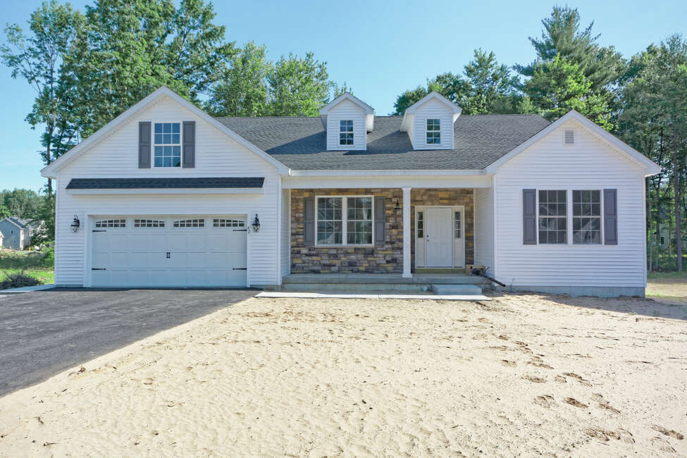 97 Balsam Way, Clifton Park: A newly built, ranch-style house by Heritage Custom Builders. It is 2,560 square feet with three bedrooms and two and a half bathrooms on slightly more than a quarter of an acre. The interior has an open layout design.