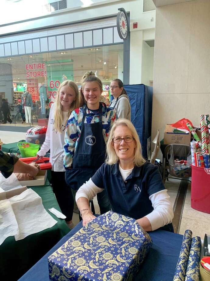 Ridgefield Academy students volunteered to wrap gifts for Habit for Humanity at Danbury Fair Mall in December. Photo: Contributed Photo