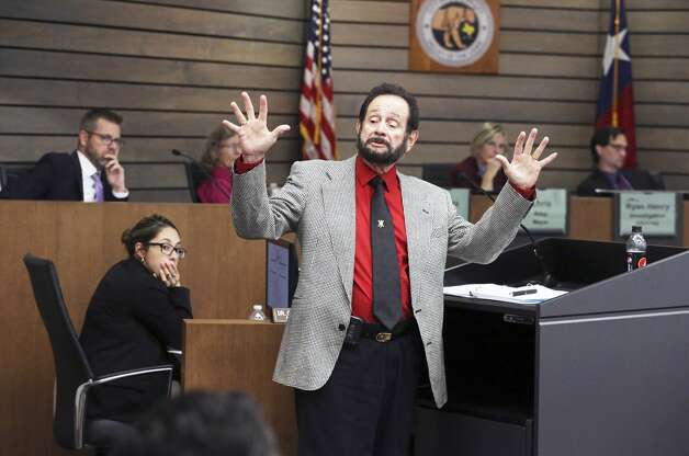 Leon Valley City Councilor Benny Martinez demonstrates his reaction in an encounter with police which is part of the points under consideration as he takes the stand in his own behalf as testimony continues in the forfeiture hearing at the Leon Valley Council Chambers on Aug. 8, 2019. Photo: Tom Reel/Staff Photographer