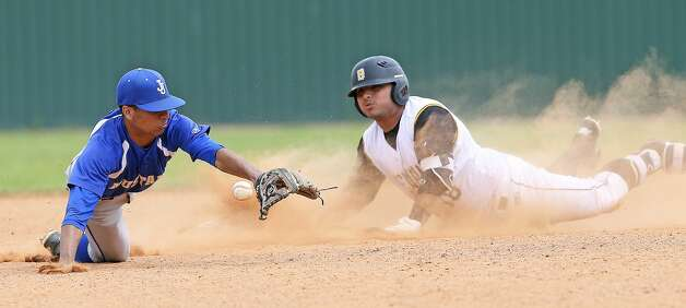 The Bear's Anthony Valle makes it in safely to second in the sixth inning as the throw to Darrell Kundinger is wide. Brennan beat Jay 10-0 in District 28-6A baseball at Northside Field 1 on March 30, 2019. Photo: Tom Reel/Staff Photographer