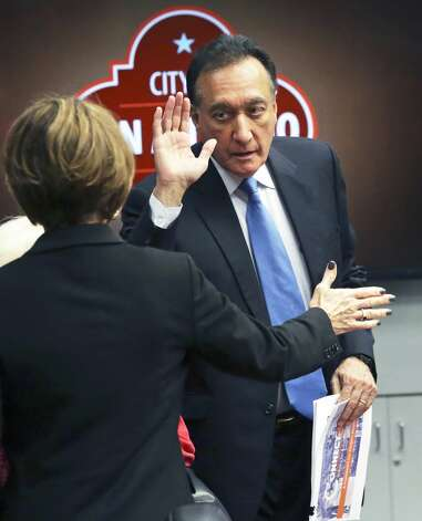 Former Mayor Henry Cisneros collects a high five from City Manager Sheryl Sculley after presenting the Connect SA transportation plan before City Council on Feb.13, 2019. Photo: Tom Reel/Staff Photographer