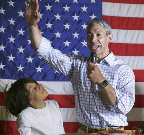 San Antonio Mayor Ron Nirenberg speaks to supporters as his son Jonah joins him onstage at the election night watch party at Augie's Barbecue on May 4, 2019. Photo: Tom Reel/Staff Photographer