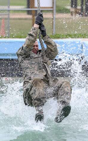 A trainee skims across the water in an exercise as Joint Base San Antonio - Lackland trainees go through the CLAW course, part of the BEAST program in their basic military training on Feb. 6, 2019. Photo: Tom Reel/Staff Photographer