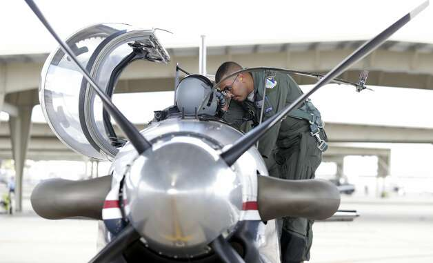 2nd Lt. Michael Gadalla checks equipment aboard his T-6 before takeoff during pilot training at Laughlin AFB on Oct. 2, 2019. Photo: Tom Reel/Staff Photographer