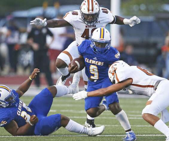 "Buffalo running back A'Mari Williams gets some running room in the open before tacklers Isaiah Edwards (49) and De""Shaun Heaggans (6) move in to stop him as Clemens hosts Madison at Lehnhoff Stadium on Aug. 30, 2019. Photo: Tom Reel/Staff Photographer"