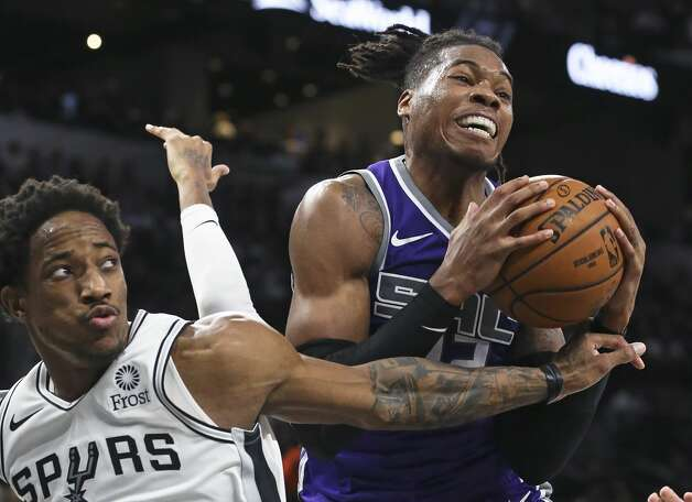Kings forward Richaun Holmes yanks an offensive rebound down in front of DeMar DeRozan as the Spurs host the Kings at the AT&T Center on Dec. 6, 2019. Photo: Tom Reel/Staff Photographer