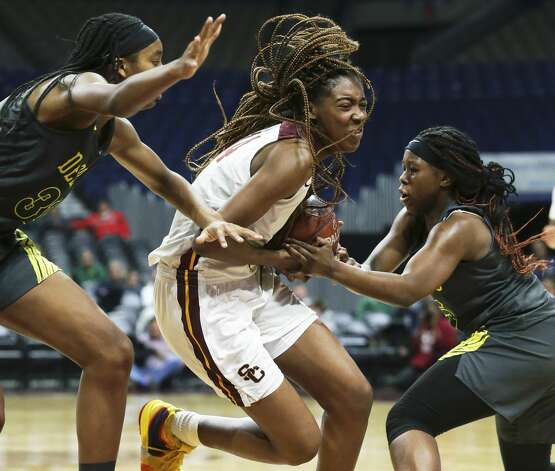 Lady Bulldog forward Maliyah Johnson gets the ball taken from her by Bria Patterson as she tries to move into the lane past Sa'Myah Smith, left, as Humble Summer Creek plays DeSoto in the semifinals of the girls Class 6A state basketball tournament at the Alamodome on March 1, 2019. Photo: Tom Reel/Staff Photographer