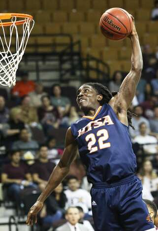 Keaton Wallace coils for a slam for UTSA after a breakaway as Texas State hosts UTSA in men's basketball at Strahan Arena on Dec. 7, 2019. Photo: Tom Reel/Staff Photographer