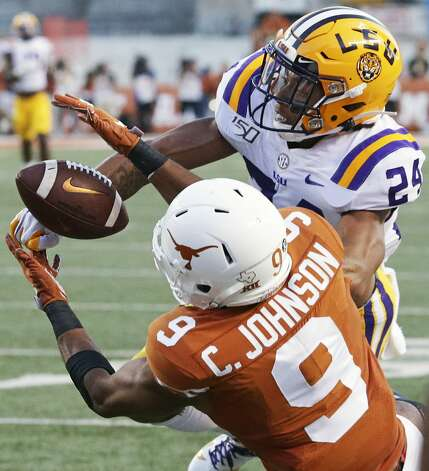 Longhorn receiver Collin Johnson battle to catch a long pass against Derek Stingley as Texas hosts LSU at Darrell K. Royal Stadium on Sept. 7, 2019. Photo: Tom Reel/Staff Photographer