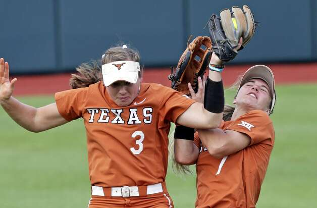 Longhorn fielders Kaitlyn Slack and Reagan Hathaway run into each other but Slack retains possession of the pop up as Sam Houston State beats Texas 2-1 in the NCAA regional tournament at MCCombs Field in Austin on May 17, 2019. Photo: Tom Reel/Staff Photographer