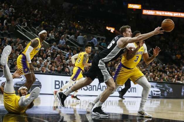 Los Angeles Lakers' JaVale McGee falls onto his back as San Antonio Spurs' Jakob Poeltl and Los Angeles Lakers' Anthony Davis go after the ball as the Spurs play the Los Angeles Lakers at AT&T Center in San Antonio on Nov. 25, 2019. Photo: Josie Norris/Staff Photographer