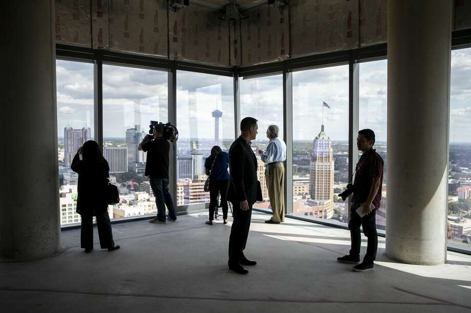 Members of the media look out of the windows on the 24th floor penthouse of the new Frost Tower Building in downtown San Antonio on Sept. 17, 2019. Photo: JOSIE NORRIS/The San Antonio Express-News