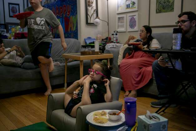 """Sammi Haney, 9, relaxes as she watches TV with her family in their San Antonio home on Sept. 30, 2019. Sammi plays a supporting role in the new Netflix series ÒRaising Dion,Ó and also has a rare form of osteogenesis imperfecta (OI), commonly known as Òbrittle bone disease."""" Photo: Josie Norris/The San Antonio Express-News"""