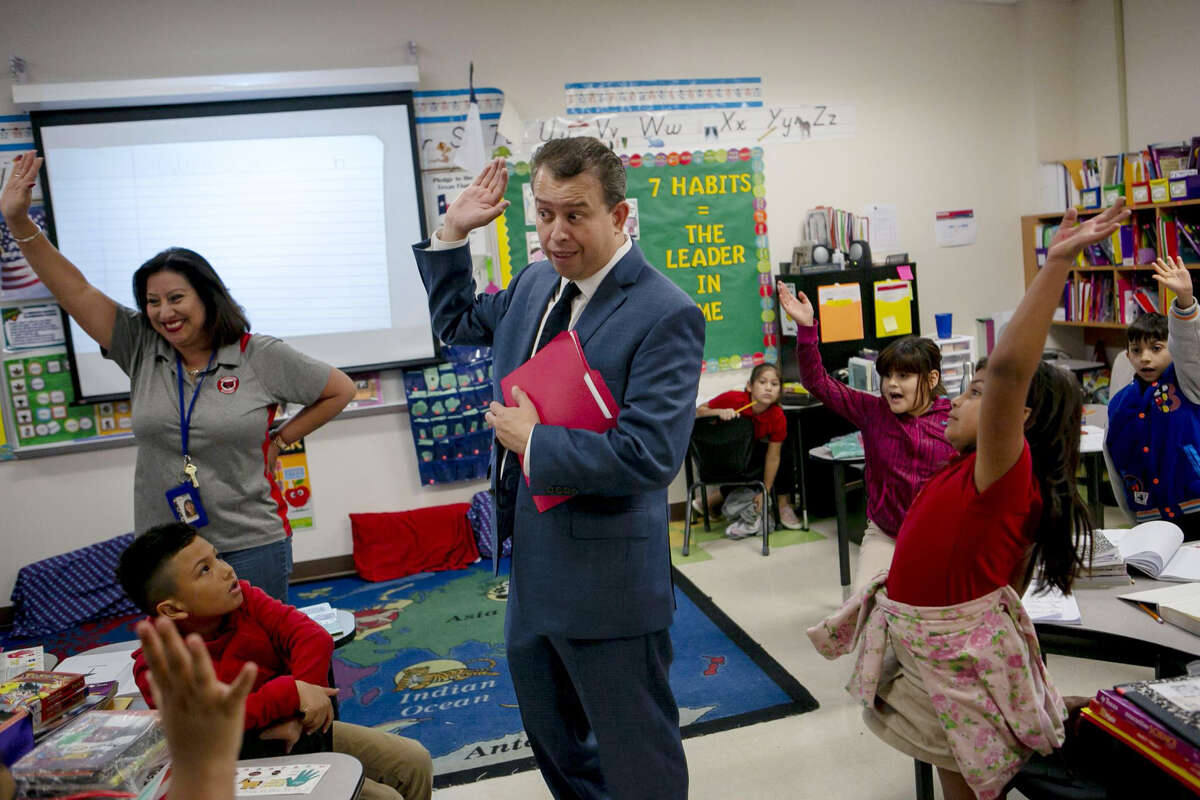 SAISD Superintendent Pedro Martinez waits for guesses after asking a classroom of second graders how many children are in the school district as he visits Hawthorne Academy in San Antonio on Oct. 29, 2019.