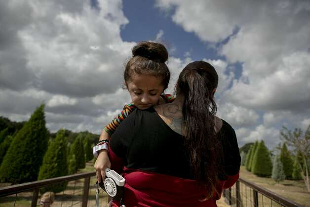 Sammi Haney, 9, is carried by her mom Priscilla Haney onto a wagon for a hay ride during a homeschool day outing at Devine Acres Farm in Devine, Texas, Oct. 2, 2019. Because of Sammi's osteogenesis imperfecta (OI), commonly known as Òbrittle bone disease,Ó she and her parents have to take precautions to keep Sammi safe while also trying to let Sammi be independent and do things able bodied kids can do. ÒPeople are all like ÔOh, I feel so sorry for them (people with disabilities).Õ They donÕt need to feel sorry- weÕre good. We can get around, we can eat by themselves. I can sit in a chair!Ó Sammi says. ÒNo one needs to feel sorry for me or anybody, itÕs the way we are.Ó Photo: Josie Norris/The San Antonio Express-News