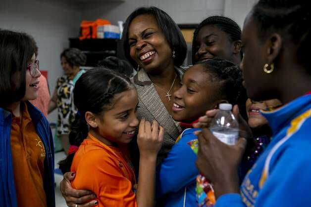 """Former San Antonio Mayor Ivy Taylor is engulfed by young women wanting to give her hugs after the program Taylor helped lead with The Links, Inc., at East Side Boys and Girls Club in San Antonio on Oct. 21, 2019. When a teacher pointed out that Taylor was the first African American woman to serve as mayor of San Antonio, young women in the class got excited and surrounded Taylor with hugs. """"You can't be it if you don't see it,"""" says Bonnie Prosser Elder, not pictured, as she watched the scene unfold. Photo: Josie Norris/The San Antonio Express-News"""