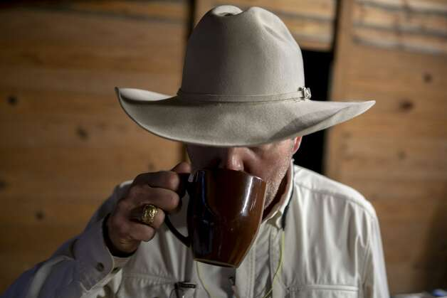 Jason Cook takes a sip of coffee before dancing lessons start at Hye Hall in Hye, Texas, on Dec. 4, 2019. Photo: Josie Norris/Staff Photographer