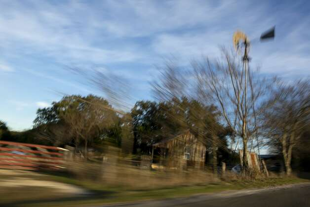Photographed with a long exposure, a farmhouse stands along Hye Albert Road in Hye, Texas, as seen on Dec. 4, 2019. Photo: Josie Norris/Staff Photographer