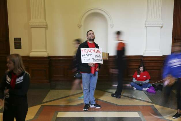 Edmundo Garza, math teacher with the Harlandale Independent School District, holds a sign inside the State Capitol in Austin, Texas, Monday, March 11, 2019. Over a thousand teachers and support staff gathered at a rally outside the capitol in support of public school funding. Photo: Jerry Lara/Staff Photographer