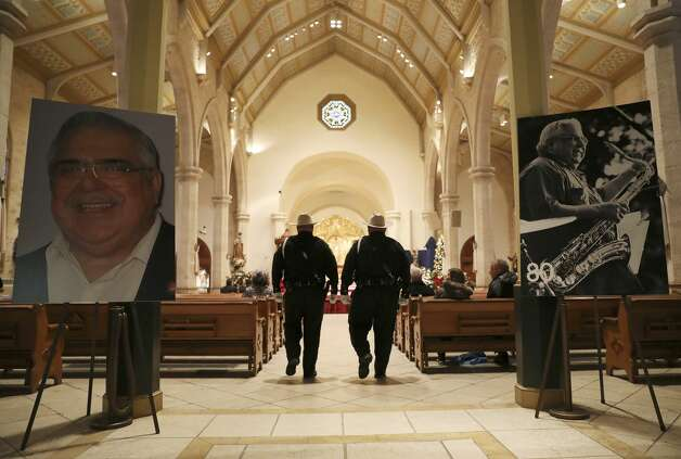 Portraits of Bexar County Commissioner Precinct 2 Paul Elizondo adorn the entrance to San Fernando Cathedral where he lies in state, Wednesday, Jan. 2, 2019. The Bexar County SheriffÕs Honor Guard provides Honor Watch over ElizondoÕs casket. Pairs of deputies take turns every 15 minutes. Elizondo who was 83, died suddenly on December 27. Photo: JERRY LARA/Staff Photographer