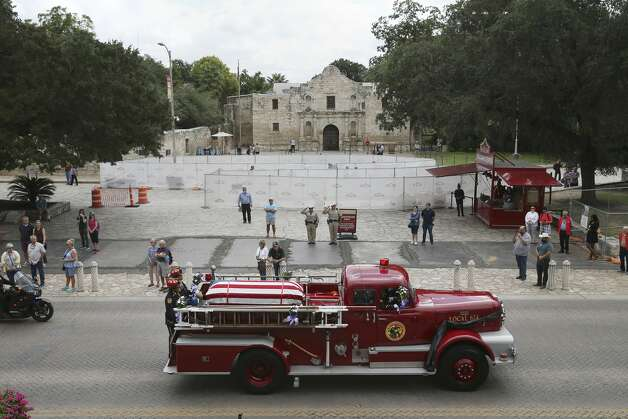 The casket of San Antonio firefighter Greg Garza is led through Alamo Plaza as the funeral procession heads to the Community Bible Church, Thursday, Oct. 24, 2019. Garza, a 17-year veteran of the fire department, was killed Oct. 14 while responding to an electrical fire at the Comfort Suites at 505 Live Oak St. Photo: Jerry Lara/Staff Photographer