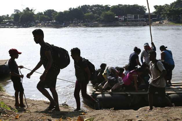 Sri Lankan migrants gets off a raft after crossing the Suchiate River from Guatemala to Mexico at Ciudad Hidalgo, Chiapas, Wednesday, June 19, 2019. The town is located by the Guatemalan border and is a popular crossing point used by migrants making their way to the U.S. through Mexico. By using the rafts, migrants avoid Mexican immigration officers stationed on the international bridges. Photo: Jerry Lara/Staff Photographer