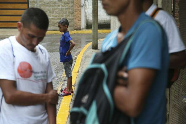 Honduran Jefferson Murillo, 9, waits with his father, outside the Belen migrant shelter in Tapachula, Mexico, Monday, June 17, 2019. The family and other migrants have been sleeping outside the shelter which was at overcapacity with over 300 migrants. Photo: Jerry Lara/Staff Photographer