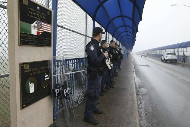 U.S. Customs and Border Protection officers guard the Eagle Pass International Bridge I, Tuesday, Feb. 5, 2019. Law enforcement personnel on the U.S. side were on high alert after a caravan with around 1,800 Central American immigrants arrived at a shelter across the Rio Grande in Piedras Negras, Mexico on Monday. Photo: Jerry Lara/Staff Photographer