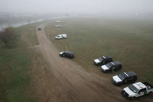 U.S. Border Patrol and Texas Department of Public Safety personnel guard the banks of the Rio Grande in Eagle Pass, Texas, Wednesday, Feb. 6, 2019. Law enforcement agencies from local to national level are on high alert after a caravan of around 1,800 Central American immigrants arrived at a shelter in Piedras Negras, Mexico across the Rio Grande from Eagle Pass on Monday. Photo: Jerry Lara/Staff Photographer