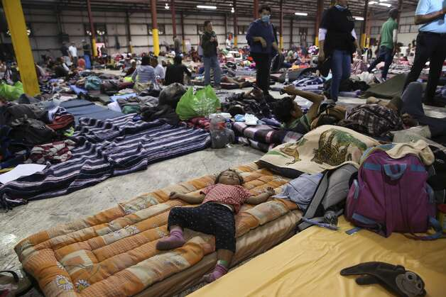 One-year-old Julivet Fernando sleeps on a mattress at a sheltered in Piedras Negras, Mexico, Tuesday, Feb. 5, 2019. The group numbering around 1,800 is at the shelter across the Rio Grande from Eagle Pass, Texas. The immigrants arrived on Monday and most are seeking asylum in the U.S. Photo: Jerry Lara/Staff Photographer