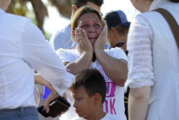 Catalina Pe–ate, 44, of El Salvador, gets emotional as she waits with other migrants at a camp in Matamoros, Mexico, Monday, Oct. 7, 2019. Pe–ate was with a group 12 LGBTQ and disable migrants that were escorted by former U.S. Secretary of Housing and Urban Development Julian Castro to seek asylum in Brownsville, Texas. Pe–ate was accompanied by her children including her 29-year-old deaf daughter, Belky. Photo: Jerry Lara/Staff Photographer