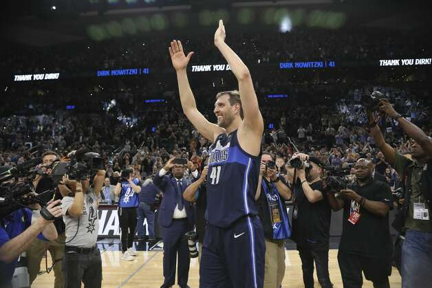 Dallas Mavericks' Dirk Nowitzki acknowledge the cheers at the end of his last career game against the San Antonio Spurs at the AT&T Center, Wednesday, April 10, 2019. The Spurs won, 105-94. Photo: Jerry Lara/Staff Photographer