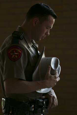 Texas Department of Public Safety Trooper Luke Rattan bows his head in prayer during a vigil at the University of Texas of the Permian Basin in Odessa, Texas on Sunday, Sept. 1, 2019. The vigil was for the victims of Saturday's mass shooting. Seth Aaron Ator, 36, of Odessa, is suspected of killing seven people an injuring 19 in a shooting spree on Saturday. Photo: Jerry Lara/Staff Photographer