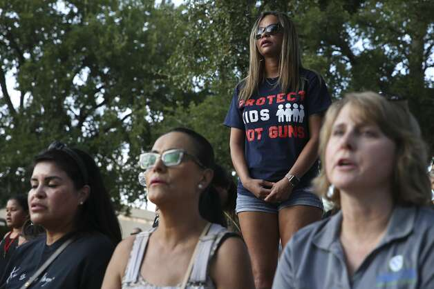 Raven Kleinbach, center top, attends a vigil at the University of Texas of the Permian Basin in Odessa, Texas on Sunday, Sept. 1, 2019. The vigil was for the victims of Saturday's mass shooting. Seth Aaron Ator, 36, of Odessa, is suspected of killing seven people an injuring 19 in a shooting spree on Saturday. Photo: Jerry Lara/Staff Photographer