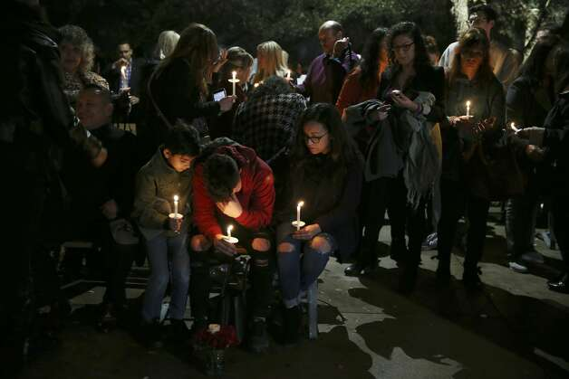 Friends and family gather for a vigil for the Olsen family at the Oblate Mission Lourdes Grotto, Wedneday, Jan. 16, 2019. The candlelight vigil was in memory of Nichol Olsen, 37, and her two daughters, Alexa Montez, 16, and London Sophia Bribiesca, 10, who were found dead at a home in Boerne last week. The Bexar County Medical has ruled the deaths murder-suicide committed by the mother. Bexar County Sheriff Javier Salazar has not closed the case and is still investigating. Photo: Jerry Lara/Staff Photographer