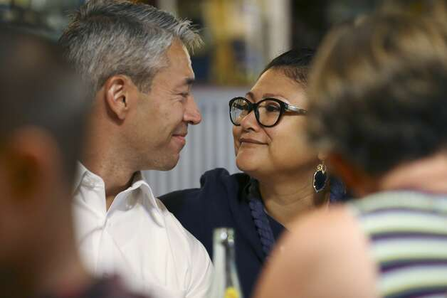San Antonio Mayor Ron Nirenberg and his wife Erika Prosper looks at each other as they gather with family and friends for lunch at Taqueria El Chilaquil in the city's west side, Sunday, June 9, 2019. Nirenberg was able to secure a slim victory in a runoff election against City Council member Greg Brockhouse on Saturday Photo: Jerry Lara/Staff Photographer