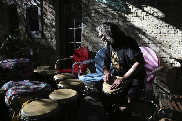 Michael Enderle, 58, right, with Kaleidoscope Nine, sets up a community drum circle at 5 Points Local, Sunday, Nov. 24, 2019. From left are Stan Piernik, 71, Bridgett Piernik-Yoder, 50, and Rick Yoder, 52. ÒEverybody is equal,Ó Enderle says about the circle, ÒitÕs just a space to bring people together. IÕve been doing this for 20 years, so what I see is that when people play together, they actually have fun.Ó Photo: Jerry Lara/Staff Photographer