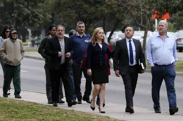 Surrounded by family and friends, former state Senator Carlos Uresti arrives to turn himself in to authorities at the John H. Wood U.S. Courthouse, Tuesday, Feb. 19, 2019. Uresti was convicted to 12 years on federal fraud charges and in another case, to five years on bribery charges. The sentences will run concurrently. He will be eligible for parole in 2029. Photo: Jerry Lara/Staff Photographer