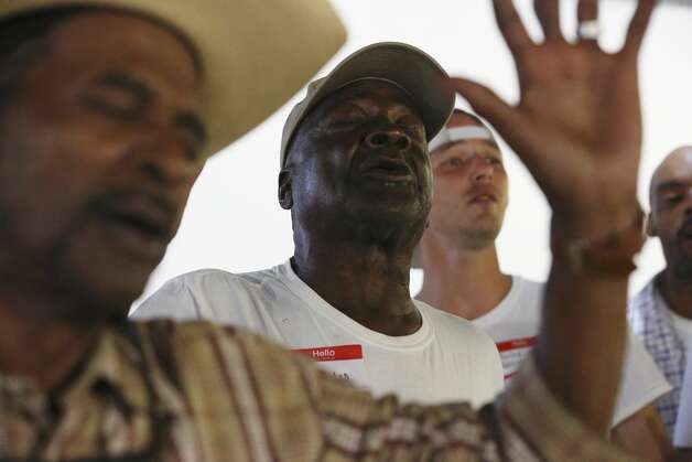Charles Jones, center, sings with the Alamo City Street Choir during a short concert at Travis Park United Methodist Church, Wednesday, Oct. 23, 2019. The choir is made up of mostly homeless people. Joining him are James Brown, left, and Kalub Adkins, right. Photo: Jerry Lara/Staff Photographer