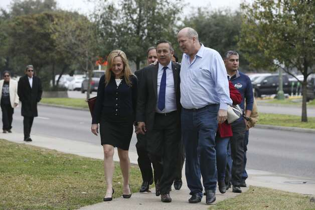 Surrounded by family and friends, former state Senator Carlos Uresti arrives to turns himself in at the John H. Wood, Jr. U.S. Courthouse, Tuesday, Feb. 19, 2019. Photo: Jerry Lara/Staff Photographer