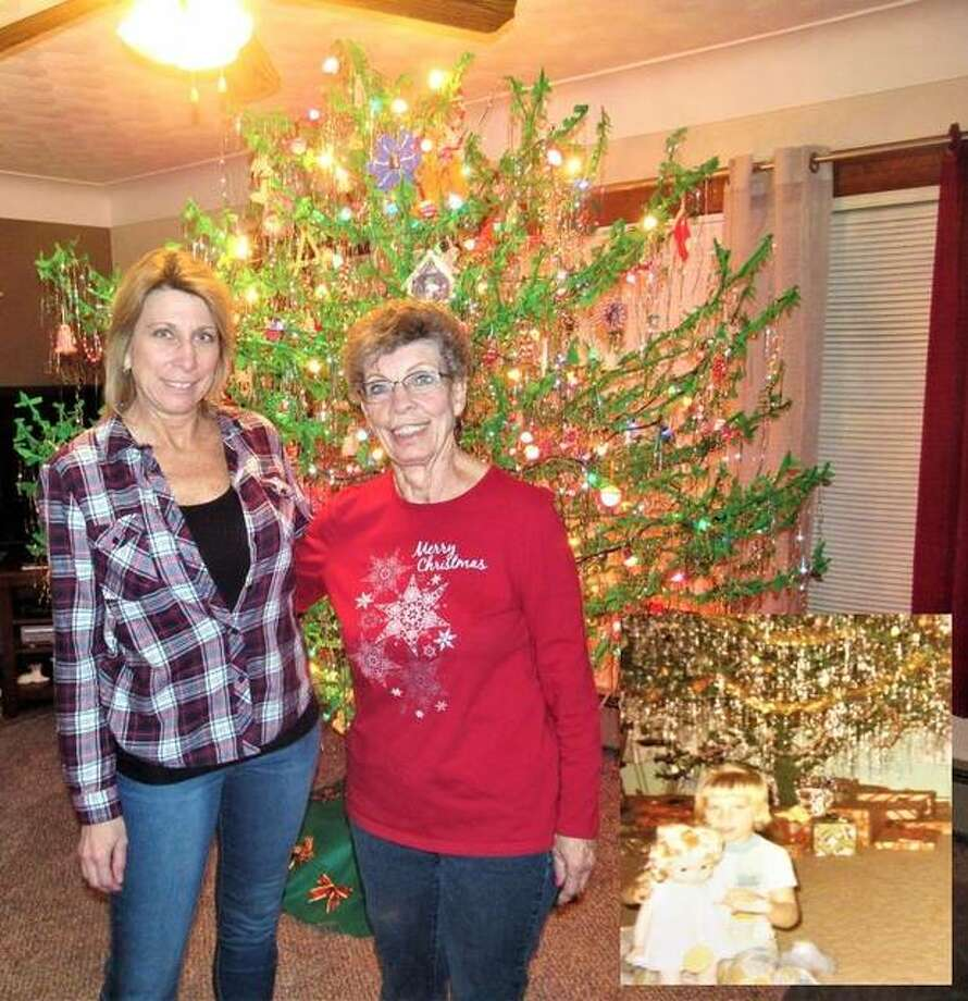 Diana Sugg, left, is carrying on a family tradition this Christmas with a sassafras tree similar to the one created by her mother, Carol Rives, in 1971, as seen in the inset. The tree is a bare sassafras tree wrapped in green crepe paper, adorned with six boxes of tinsel, 200 handmade ornaments and 400 lights.