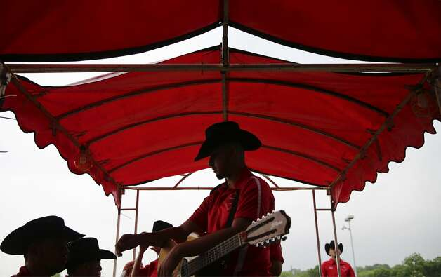 Jose Nunez of Conjunto Los Diamantes from La Joya, Texas waits with his guitar and his band members before taking the stage to perform as the Guadalupe Cultural Arts Center hosts the annual Tejano Conjunto Festival at Rosedale Park on Saturday, May 18, 2019. The musical and cultural event is now in its 38th year and considered the longest running celebration of conjunto music in the country. Photo: Kin Man Hui/Staff Photographer