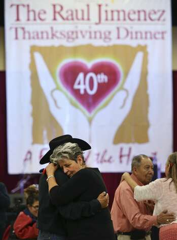 Irasema Cavazos (foreground) and Juan Munoz joins others in a dance at the 40th annual Jimenez Thanksgiving dinner that serves meals to thousands of guests at the Convention Center on Thursday, Nov. 28, 2019. The San Antonio tradition started by Restauranteur Raul Jimenez and continued by his daughter Patricia Jimenez offers a Thanksgiving day meal to 22,000 people. Photo: Kin Man Hui/Staff Photographer