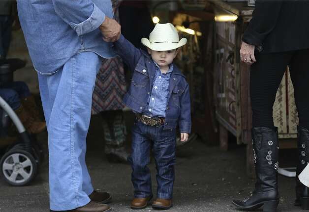 Two-and-a-half year old Jacob Treviso is dressed in his finest cowboy duds as he visits the opening day of the 2019 San Antonio Stock Show and Rodeo with his grandparents Juan and Mary-Martha Gamboa on Thursday, Feb. 7, 2019. Photo: Kin Man Hui/San Antonio Express-News