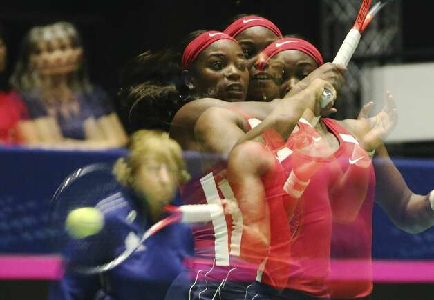A multiple exposure image of USA's Sloane Stephens hitting the ball against Switzerland's Timea Bacsinskzky during their Federation Cup match at the Freeman Coliseum on Saturday, Apr. 20, 2019. Stephens defeated Bacsinszky, 6-4, 6-3, to give USA a 1-1 tie with Switzerland. Photo: Kin Man Hui/Staff Photographer