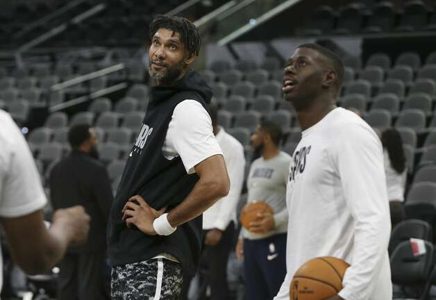 Spurs assistant coach Tim Duncan watches players during shoot around before the pre-season game against the Memphis Grizzlies at the AT&T Center on Friday, Oct. 18, 2019. Photo: Kin Man Hui/Staff Photographer