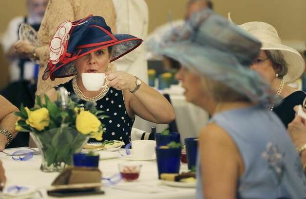 Traci McCullough takes a sip of tea as the Alamo Trust, the nonprofit that now operates the Texas shrine, hosts key leaders of the Daughters of the Republic of Texas, including the DRT Mission Chapter, to a high tea party at the Alamo on Tuesday, July 16, 2019. Photo: Kin Man Hui/Staff Photographer