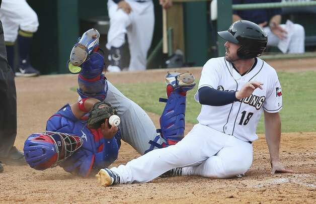 Missions' Travis Shaw (18) gets called safe as he slides home for a score against Iowa Cubs catcher Francisco Arcia (16) in the seventh inning at Wolff Stadium on Wednesday, July 3, 2019. Missions lose to the Cubs, 2-5. Photo: Kin Man Hui/Staff Photographer